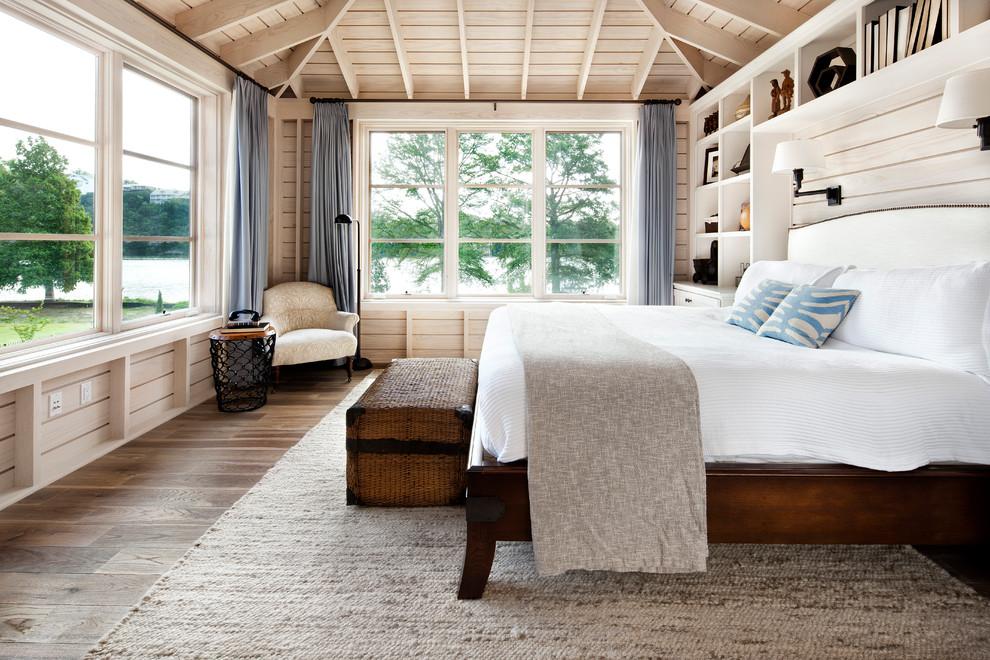 Elegant light wood floor bedroom photo in Austin