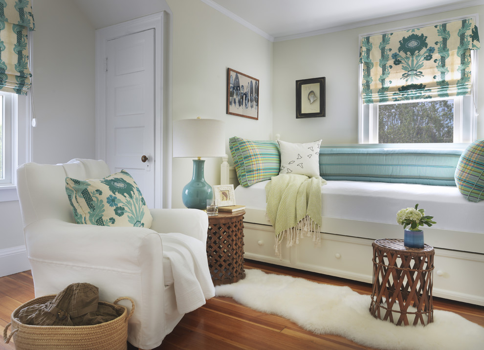 Example of a beach style guest medium tone wood floor bedroom design in Providence with green walls