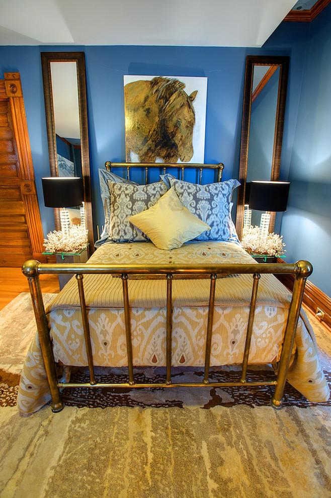 Bedroom - eclectic bedroom idea in Calgary with blue walls