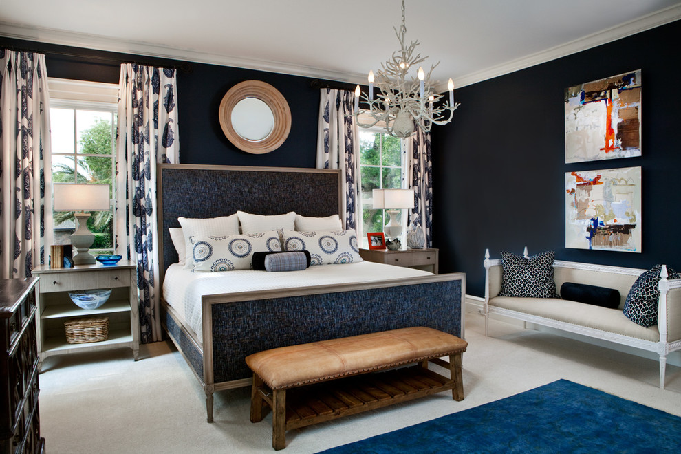 Example of a transitional master carpeted bedroom design in Orlando with blue walls