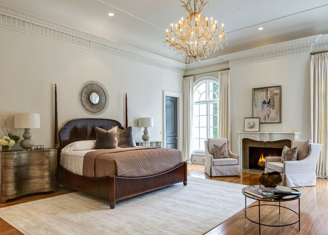 Bedroom - traditional master medium tone wood floor bedroom idea in Atlanta with beige walls, a standard fireplace and a stone fireplace