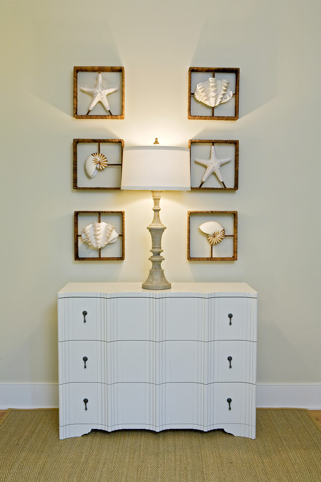 Inspiration for a coastal bedroom remodel in Charleston with beige walls