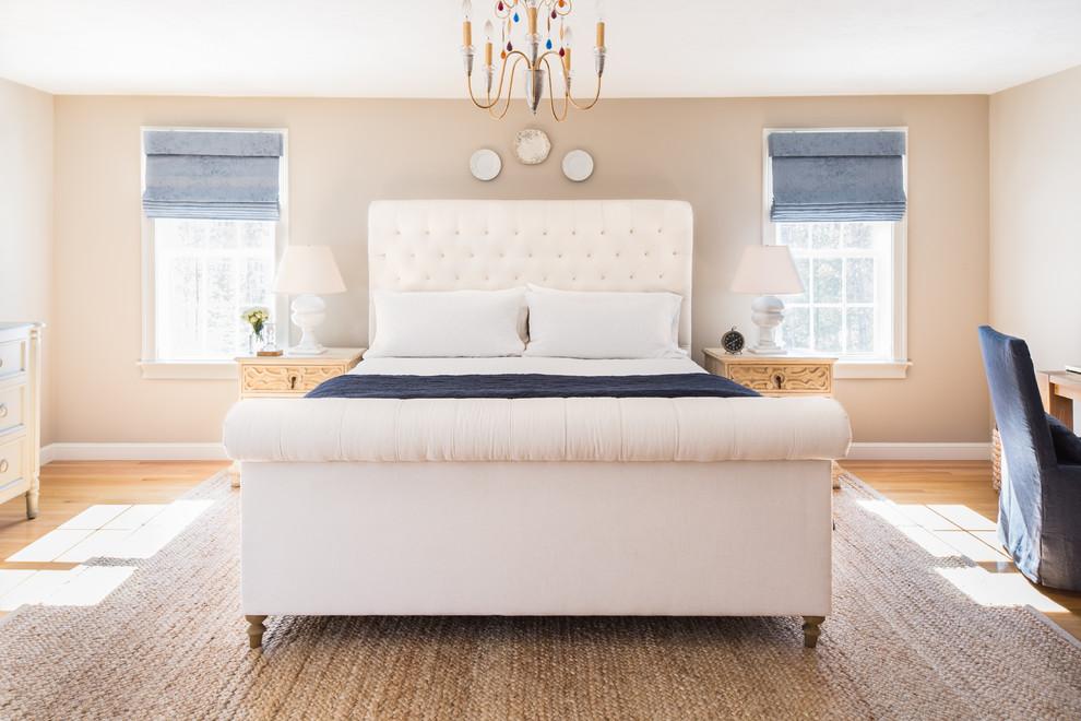 Bedroom - large cottage master medium tone wood floor bedroom idea in Boston with beige walls