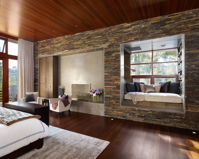 Inspiration for a modern dark wood floor bedroom remodel in Los Angeles  with beige walls
