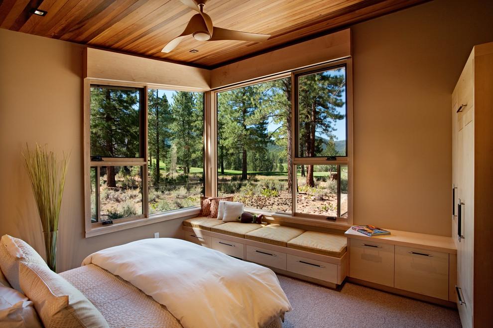 Bedroom - rustic carpeted bedroom idea in Sacramento with beige walls