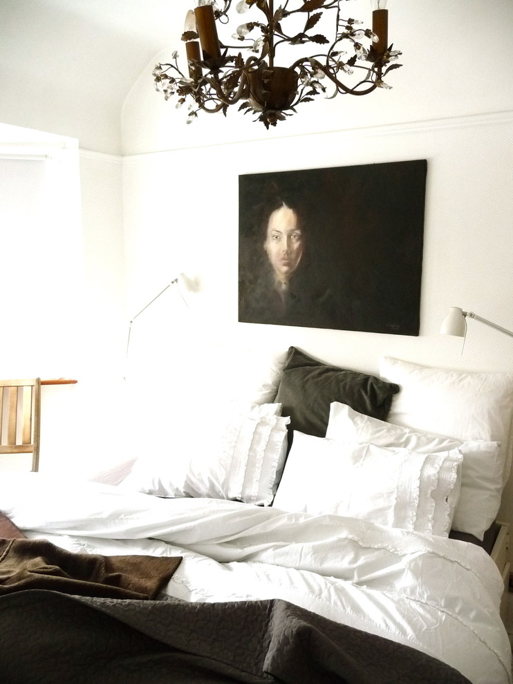 Example of an eclectic bedroom design in Other with white walls