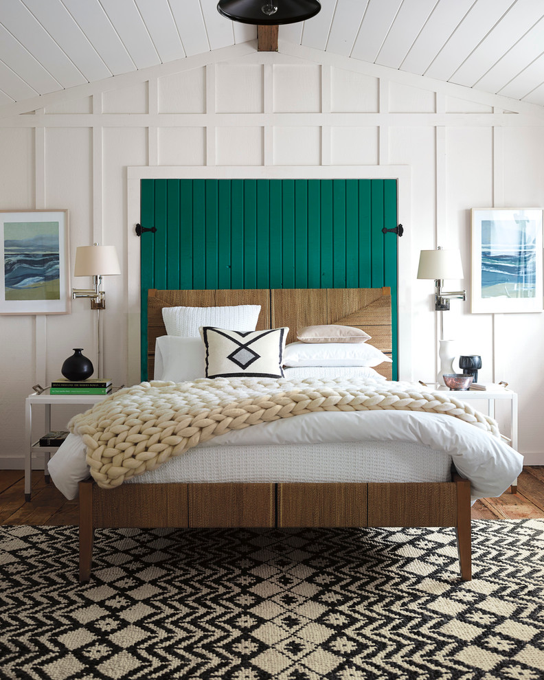 Bedroom - mid-sized coastal medium tone wood floor bedroom idea in San Francisco with white walls and no fireplace