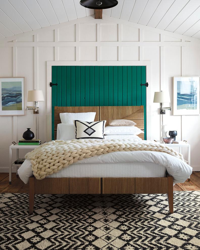 Bedroom - mid-sized beach style medium tone wood floor bedroom idea in San Francisco with white walls