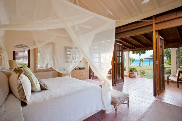 tropical bedroom by MCM Design
