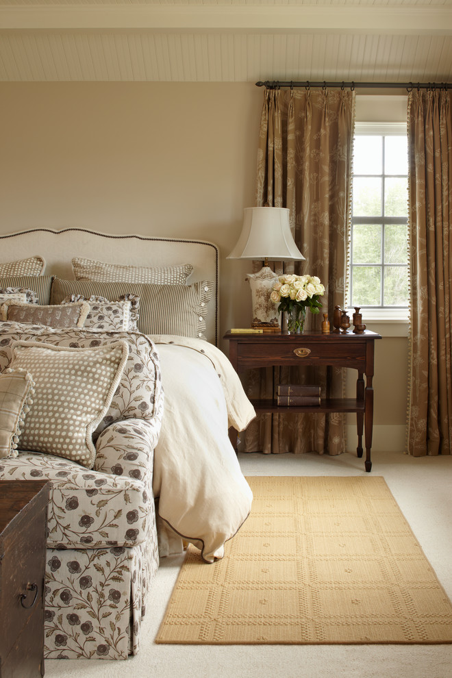 Example of a country carpeted bedroom design in Denver with beige walls