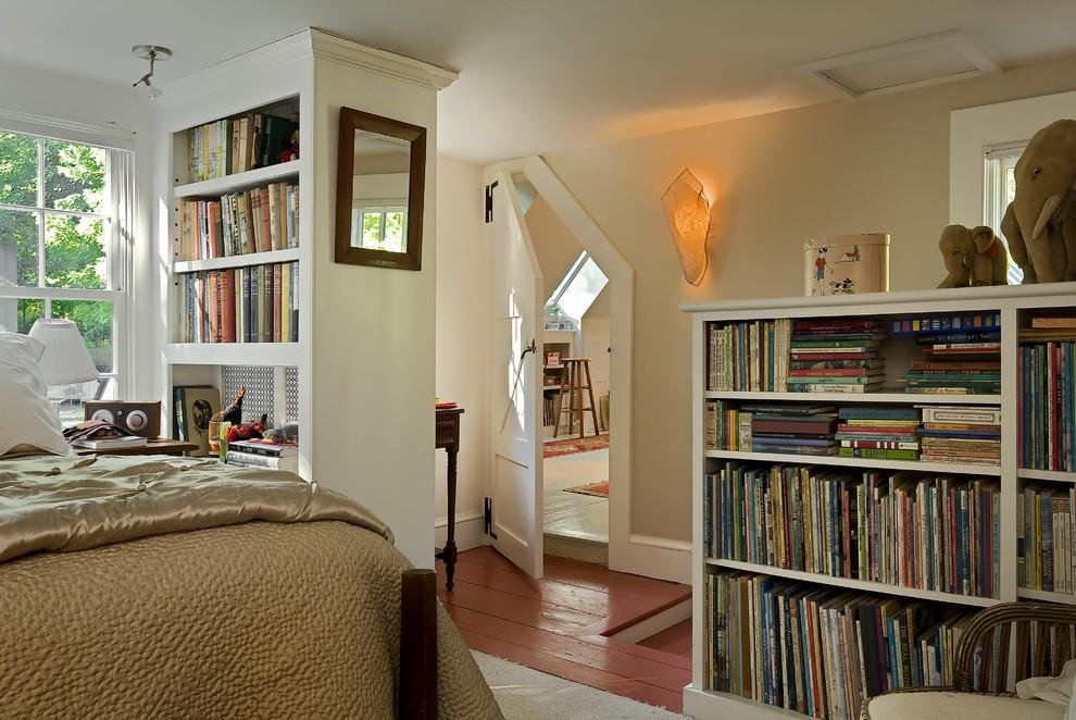 Example of a classic red floor bedroom design in Burlington with beige walls