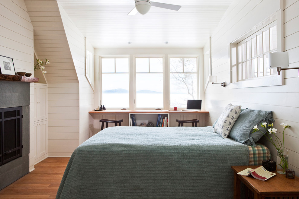 Elegant medium tone wood floor bedroom photo in Boston with white walls