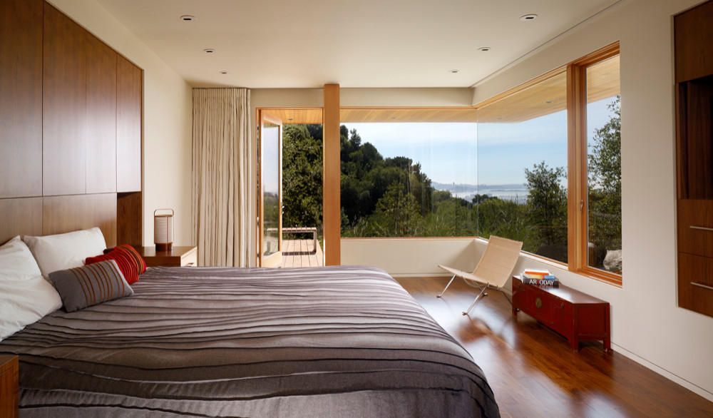 Bedroom with built in storage, hardwood floors, and lots of natural light