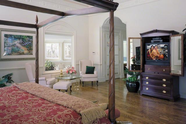 Bedroom With Hidden TV In Cabinet