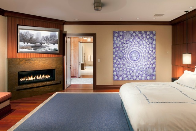 bedroom with tv and gas fireplace