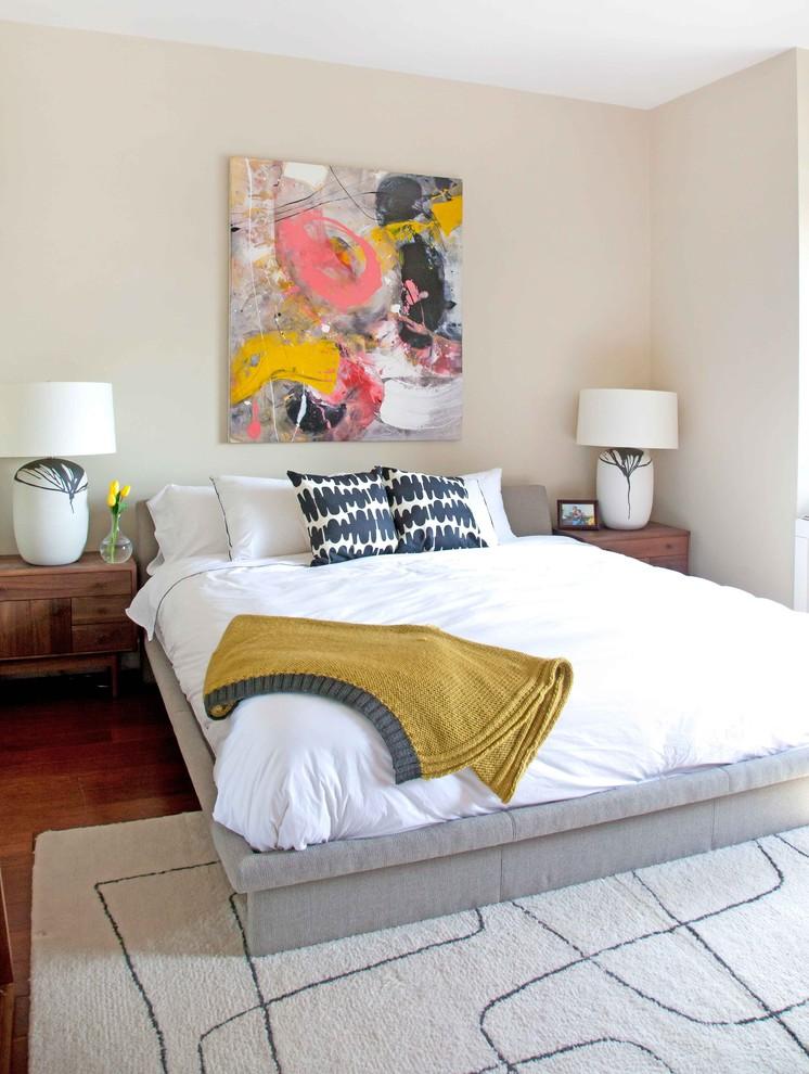 Example of a trendy dark wood floor bedroom design in Seattle with beige walls