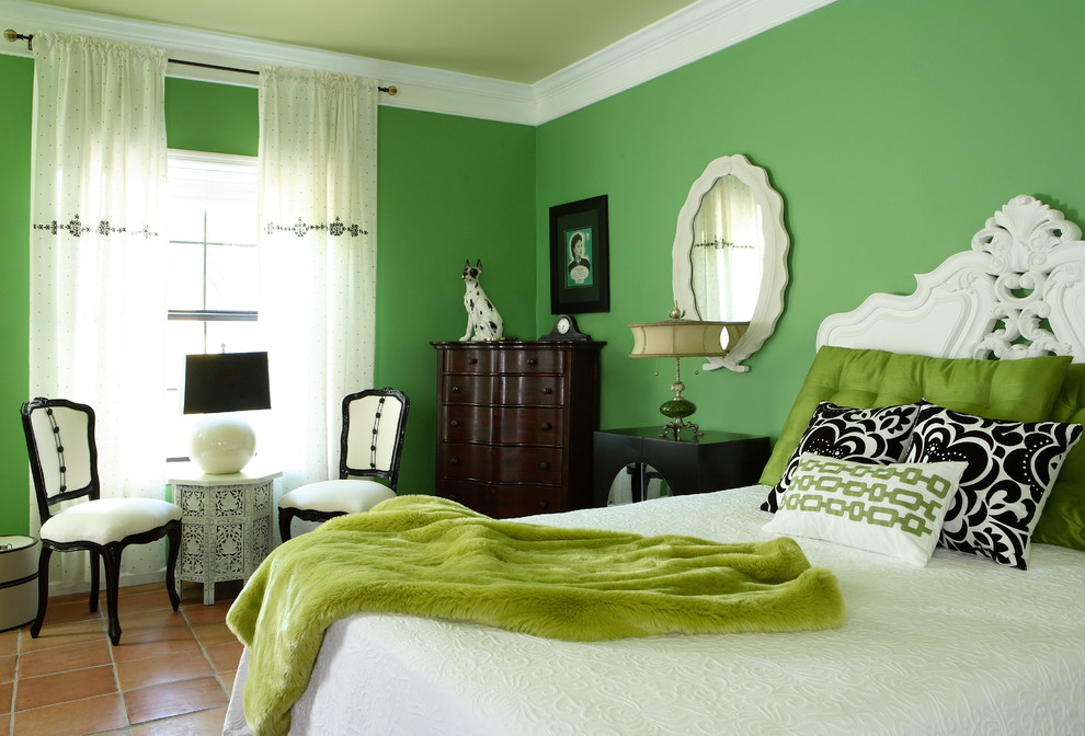 Example of a large eclectic guest terra-cotta tile bedroom design in Atlanta with green walls and no fireplace