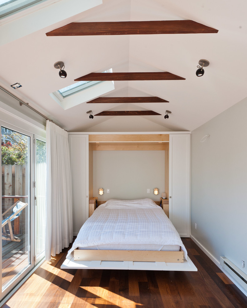 Inspiration for a contemporary guest dark wood floor bedroom remodel in San Francisco with white walls and no fireplace