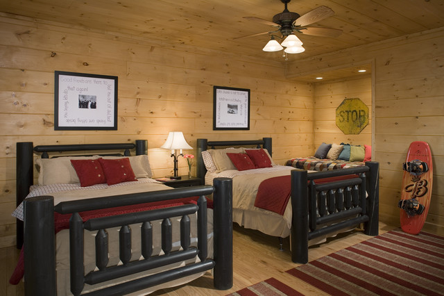 bedrooms in a rustic round log home  traditional  bedroom,