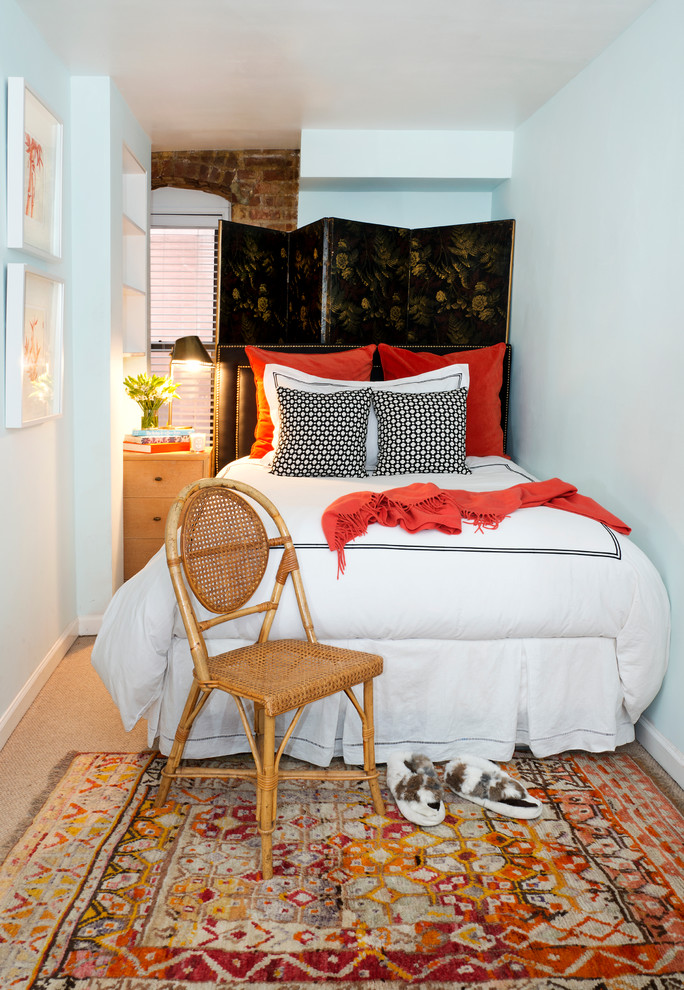 Eclectic bedroom photo in New York with white walls