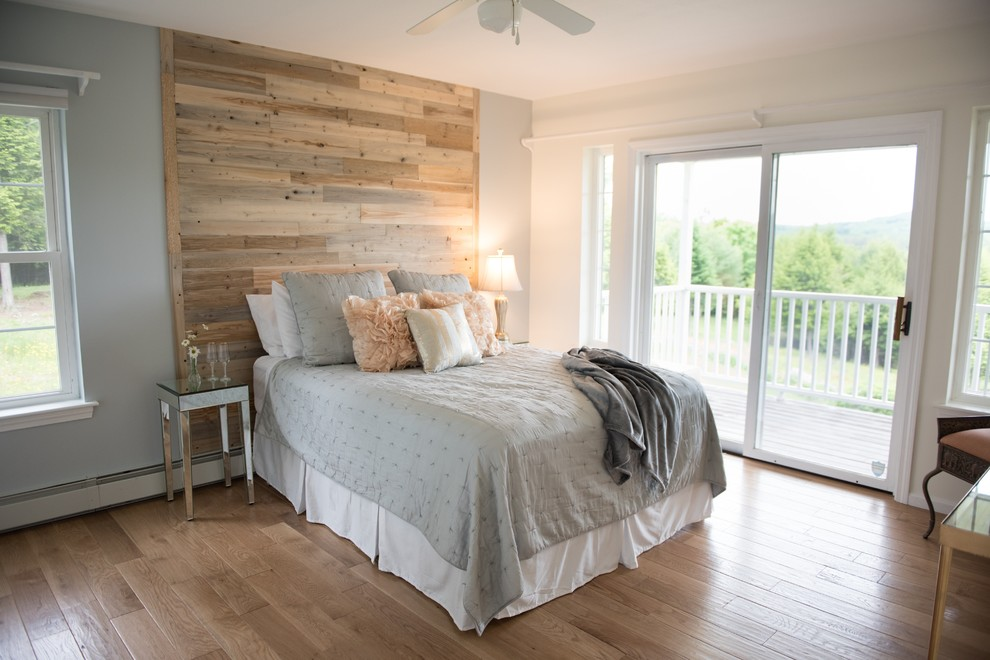 Example of a mid-sized transitional master light wood floor and beige floor bedroom design in Other with gray walls and no fireplace