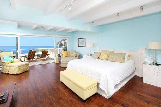 Inspiration For A Tropical Bedroom Remodel In Orange County With Blue Walls