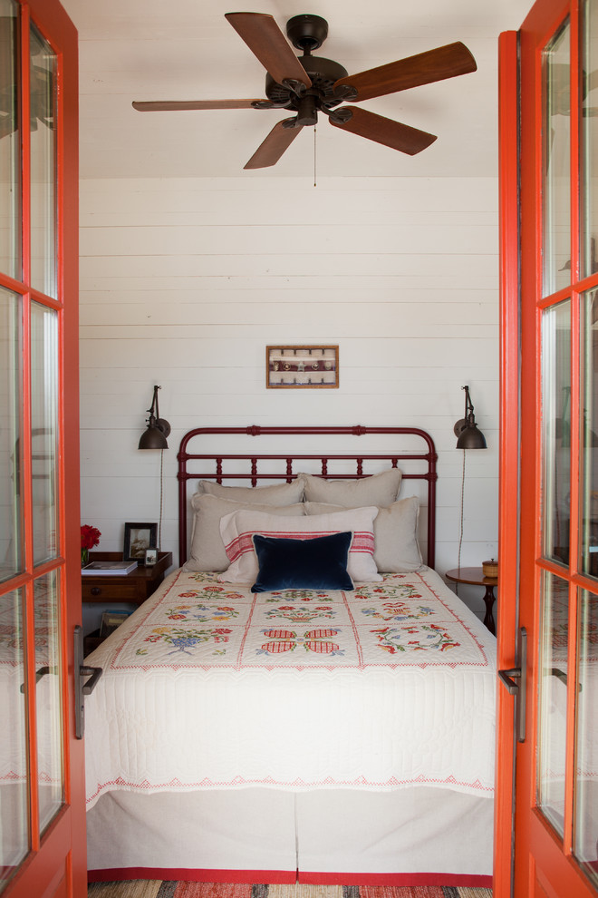 Example of a farmhouse bedroom design in Atlanta with white walls