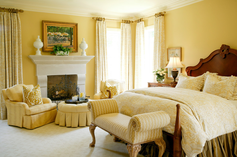 Bedroom - traditional carpeted bedroom idea in Little Rock with yellow walls and a standard fireplace