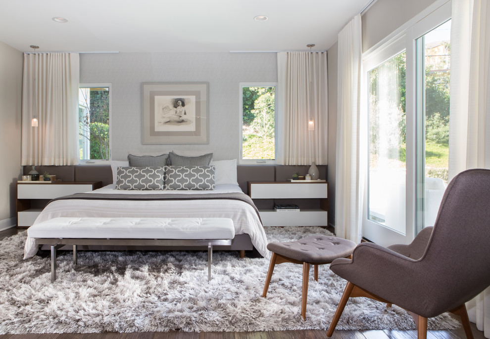 Trendy dark wood floor bedroom photo in Los Angeles with gray walls
