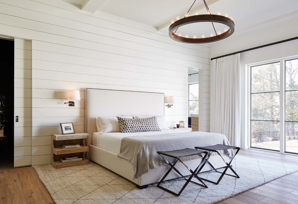 Bedroom - country master light wood floor bedroom idea in Charlotte with white walls