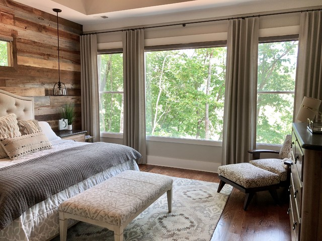 Inspiration for a mid-sized rustic master medium tone wood floor and brown floor bedroom remodel in Atlanta with gray walls