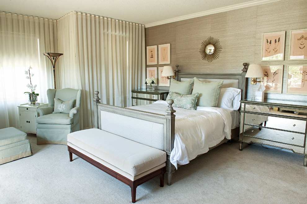 Example of a classic carpeted bedroom design in Jacksonville with beige walls