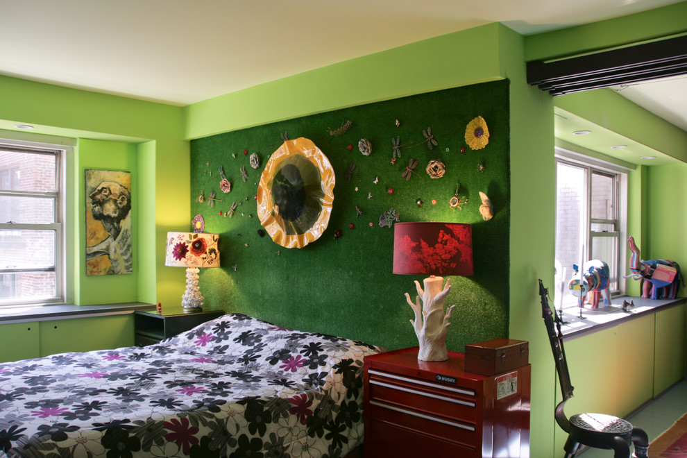 Example of an eclectic bedroom design in New York with green walls