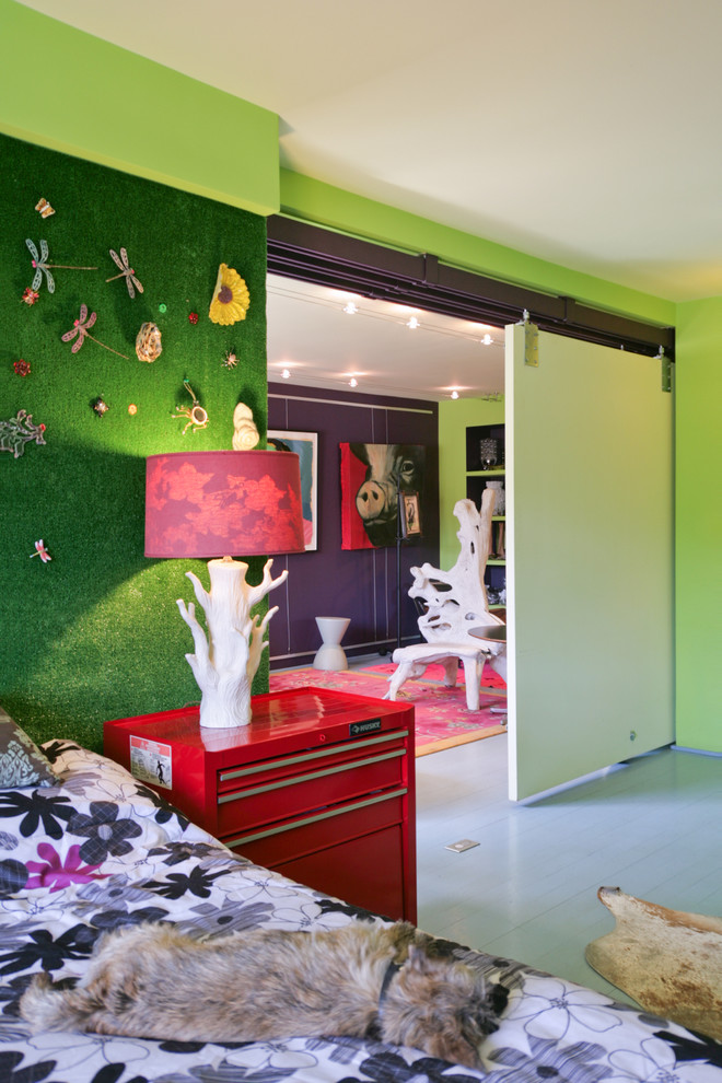 Eclectic bedroom photo in New York with green walls