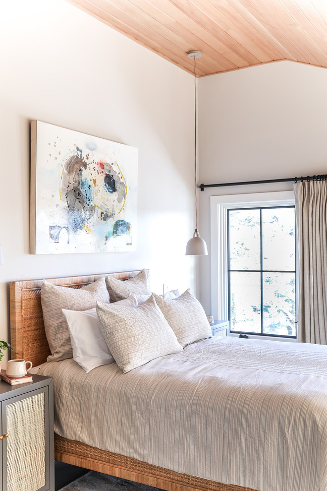Bedroom - mid-sized modern master medium tone wood floor and brown floor bedroom idea in Portland Maine with white walls