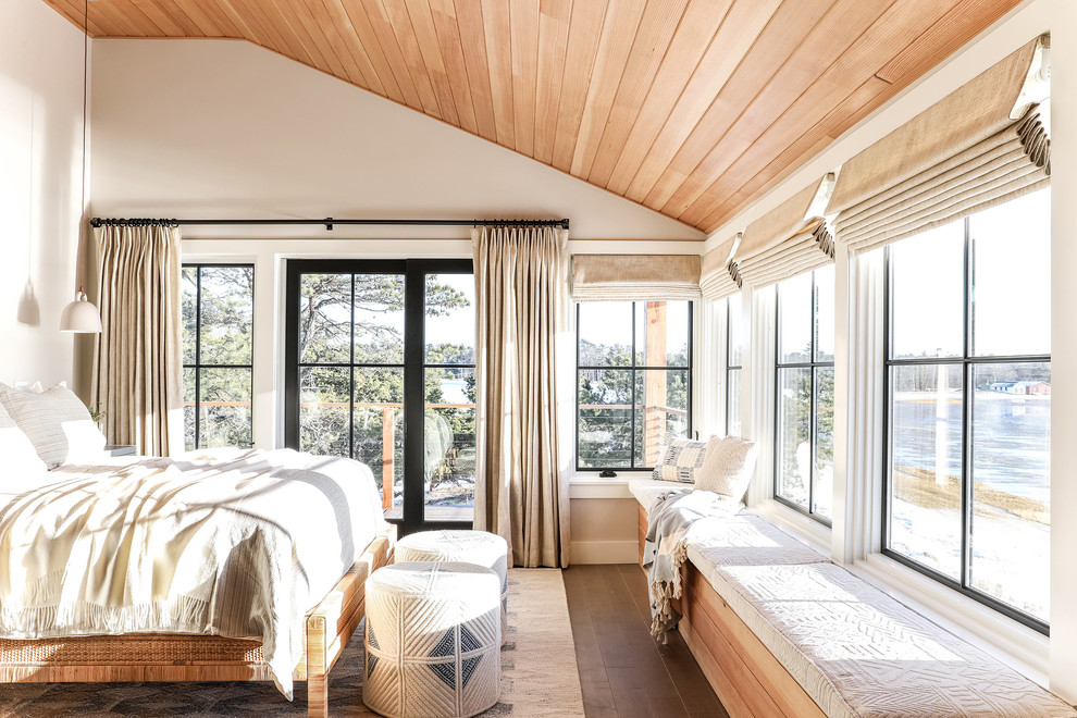 Mid-sized beach style master medium tone wood floor and brown floor bedroom photo in Portland Maine with white walls