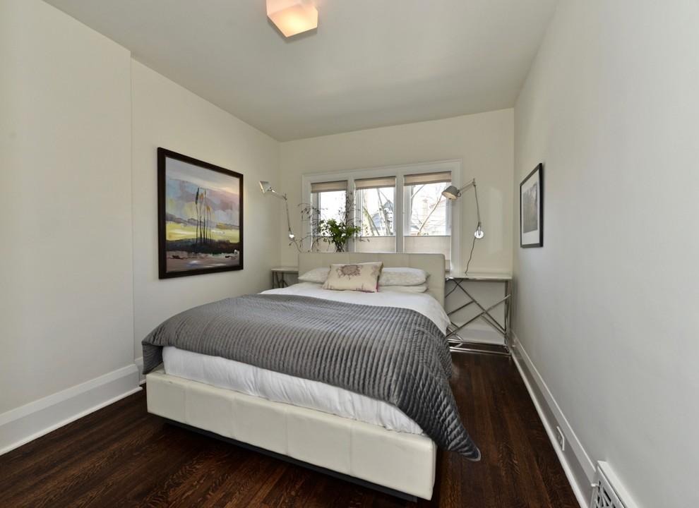 Bedroom - small contemporary master dark wood floor and brown floor bedroom idea in Toronto with white walls