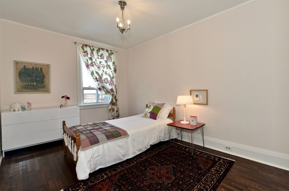 Inspiration for a small shabby-chic style guest dark wood floor and brown floor bedroom remodel in Toronto with pink walls