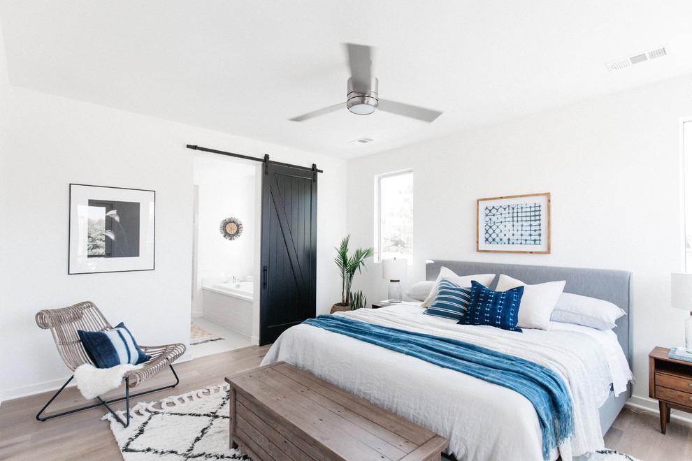 Bedroom - coastal dark wood floor and brown floor bedroom idea in Los Angeles with white walls