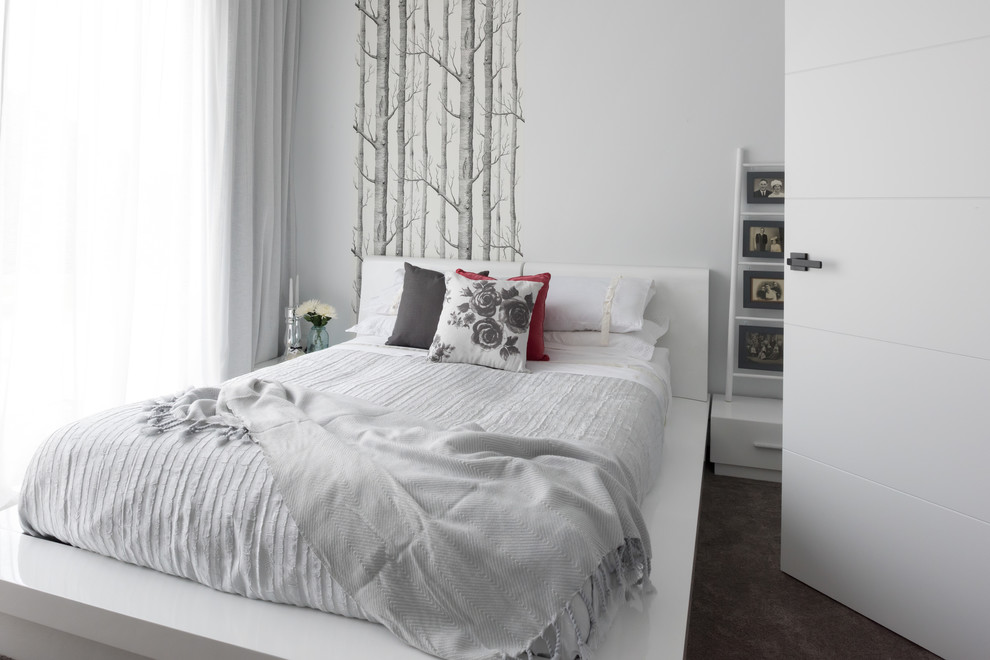 Trendy carpeted and gray floor bedroom photo in Other with white walls