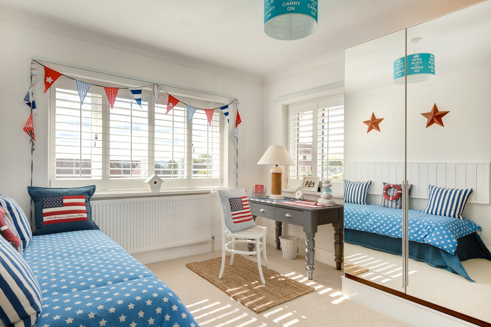 Beach style carpeted bedroom photo in Devon with white walls