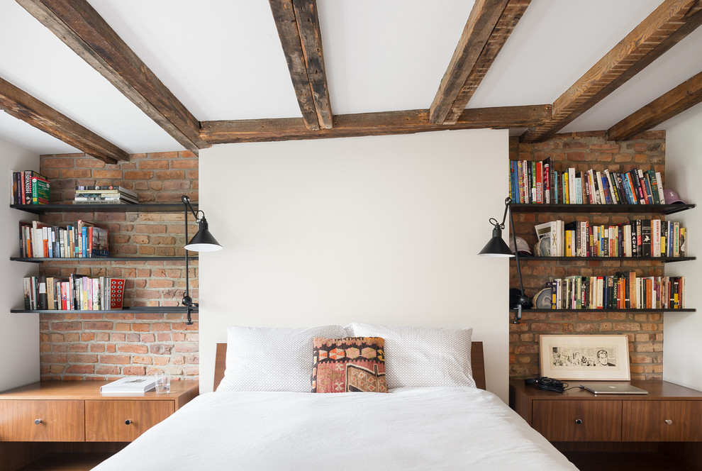 Inspiration for a classic bedroom in New York with white walls.