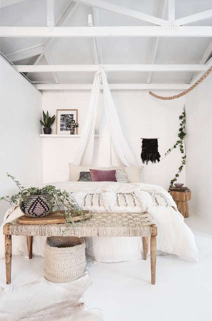Bohemian beach style bedroom featuring handmade wall hangings contemporary-bedroom