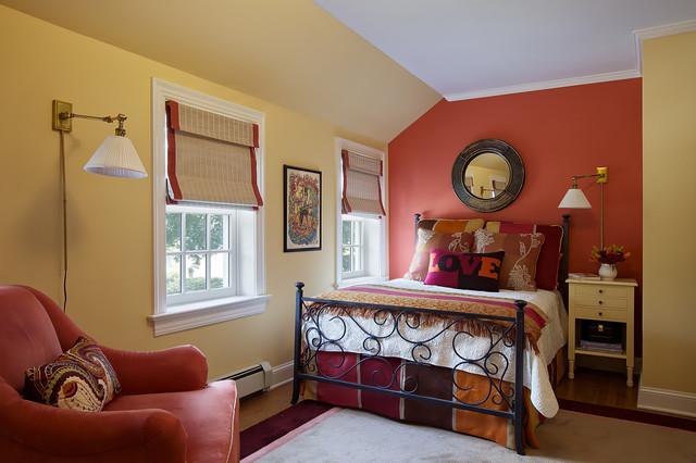 mid sized elegant guest light wood floor and beige floor bedroom photo in new york