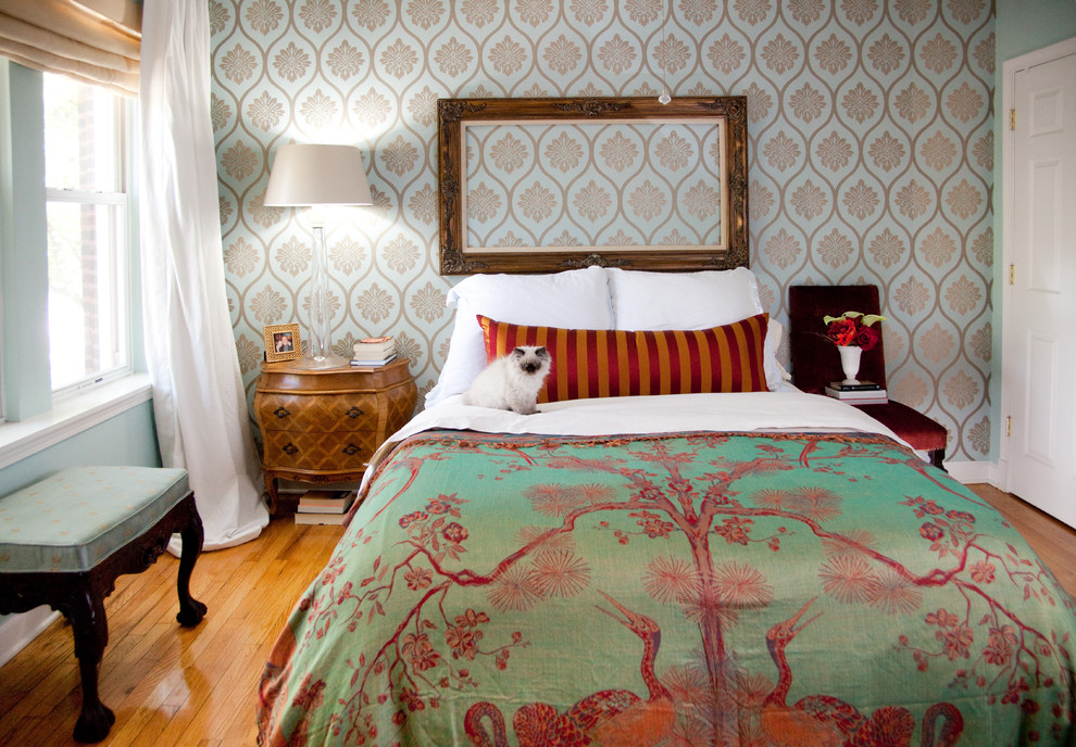Eclectic medium tone wood floor bedroom photo in Chicago with multicolored walls