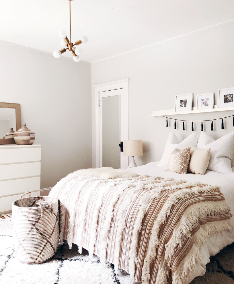 Example of a mid-sized transitional master medium tone wood floor bedroom design in Boston with gray walls