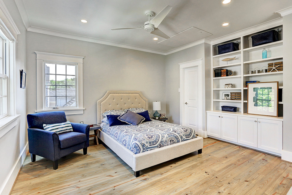 Mid-sized transitional guest light wood floor and brown floor bedroom photo in Houston with gray walls and no fireplace