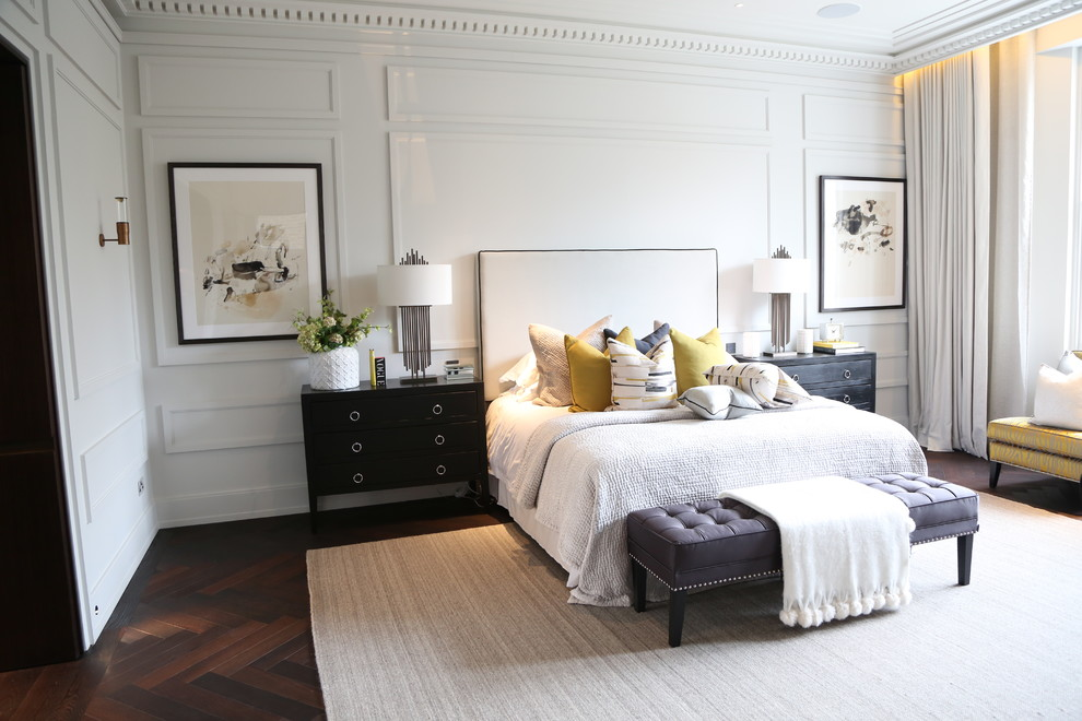 Classic master bedroom in London with white walls and dark hardwood flooring.