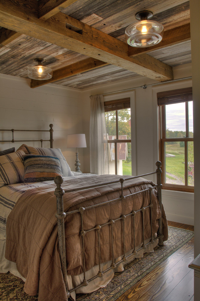 Mid-sized cottage guest medium tone wood floor and brown floor bedroom photo in Minneapolis with white walls