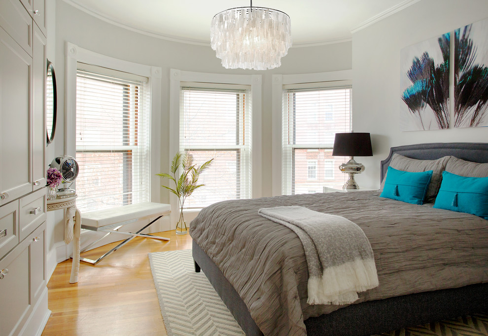 Inspiration for a transitional medium tone wood floor bedroom remodel in Boston with gray walls
